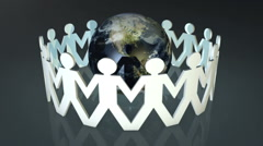 Paper chain people holding hands around the world Stock Footage