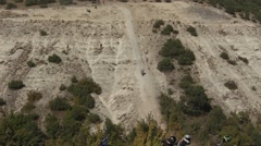 Moto Cross Biker is Jumping over Hill at the Competition Stock Footage