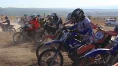 Mass Start of Many Motobikes at the Motocross Competition Stock Footage