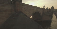 Aerial camera rises up the side of the Charles Bridge Stock Footage