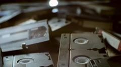 Scattered old VHS tapes Stock Footage