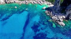 Flight over ocean sea water Greece Corfu cliff rocky coast harbor bay 4k video Stock Footage