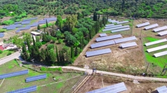 Solar power panels ECO sun farm countryside. Alternative energy 4k aerial video Stock Footage