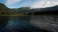 Alaskan Scenic Mountain Hovering Low over Rippling Water in Evening Aerial Stock Footage