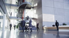 4K Time lapse of large group business people in modern corporate office building Stock Footage