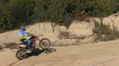Moto Cross Biker is Jumping over Hill Stock Footage