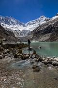 Llaca lagoon in the peruvian Andes and Ocshapalpa peak and Ranrapalca peak Stock Photos