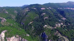 Flight over Greece Corfu mountain village aerial 4k travel video. Houses hills Stock Footage
