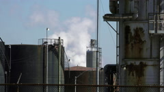 Refinery Tanks and Steam Stock Footage