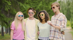 Young cheerful couples talking and laughing, remembering good funny moments Stock Footage