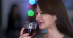 Young Asian woman in bar setting with red wine 4K Stock Footage