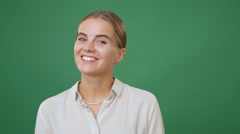 Young blonde woman smiling and laughing, green screen background Stock Footage