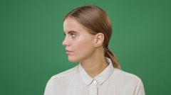 Close up young sad woman in white shirt turning away the face, green screen b Stock Footage