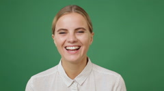 Close up young woman widely smiling, green screen background Stock Footage