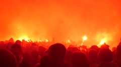 Football ultras Fans supporters burn flares. Riots on the street, city in fire Stock Footage