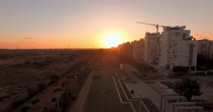 Sunset. Aerial view of town park,buildings. Israel. 4K. Stock Footage