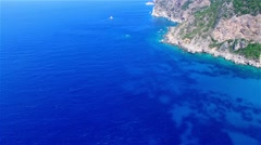 Flight aerial ocean sea water Paleokastritsa bay rocky coast Corfu 4k video Stock Footage