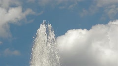 Fountain water splash against the cloudy sky Stock Footage