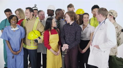 4K Diverse group of professionals from different occupations in studio shot Stock Footage
