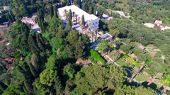 Flying aerial Achilleion Sissi's Palace Greece Corfu 4k video panorama Stock Footage