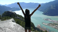 Young Girl Successfully Climbs Mountain With Gorgeous View Stock Footage
