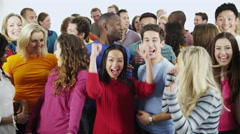 4K Happy, diverse group in casual clothing raise their hands Stock Footage