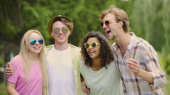 Female and male friends in sunglasses singing, dancing on summer day, holidays Stock Footage