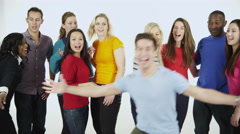 4K Portrait of happy multi-ethnic group of friends in colorful casual clothing Stock Footage