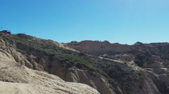 People Walking Cliff Trails To Beach- Torrey Pines California Stock Footage