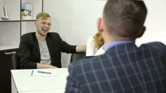 Young businessman talking with clients at office. Attractive manager in jacket. Stock Footage