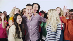 4K Happy, energetic group jumping & cheering, isolated on white in a studio shot Stock Footage