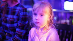 Beautiful small girl in a nightclub waiting start of the show. Stock Footage