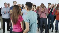 4K Happy, diverse group in casual clothing, isolated on white in a studio shot Stock Footage