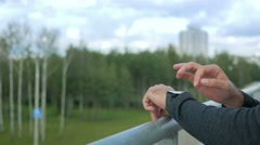 Outdoor portrait of modern young man with smart watch. Against the background of Stock Footage