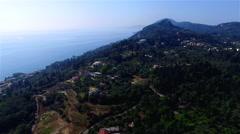 Flying aerial Corfu village countryside ocean sea coast Greece 4k video Stock Footage