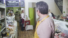 4K Portrait of a happy male shopkeeper in a delicatessen or food store Stock Footage