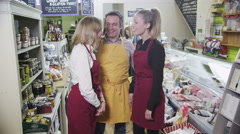 4K Portrait of a happy team of workers in a delicatessen or whole foods store. Stock Footage
