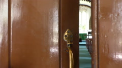 Opening church door and entering Stock Footage