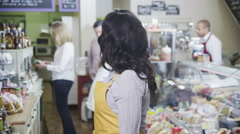4K Portrait of a happy female shopkeeper in a delicatessen or food store Stock Footage