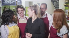 4K Portrait of happy workers in a delicatessen or whole foods store. Stock Footage