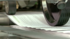 Printed sheets coming out of commercial printing press Stock Footage
