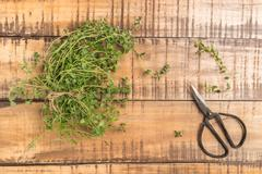 Bunch of thyme on old wooden board Stock Photos