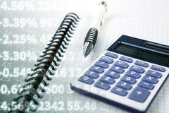Calculation of cash earnings and digits Stock Photos