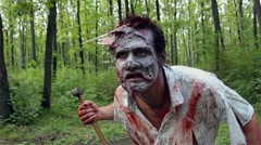 Crazy scary zombie standing in the woods and looking for the victim Stock Footage