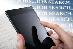 People looking for a job on the Internet Stock Photos