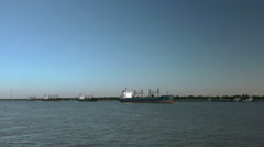 Passing cargo ships lined up on Mississippi river Stock Footage