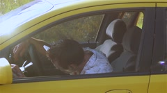 Zombie monster sitting behind the wheel of the car and waving hands. Stock Footage