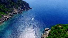 Ship boat sailing Paleokastritsa bay Greece Corfu aerial 4k video Gulf ocean sea Stock Footage