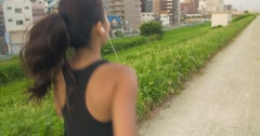 Healthy Japanese women jogging lifestyle exercise singlet moving shot.mp4 Stock Footage
