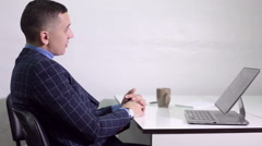 A businessman talking with customers at the office. Side view Stock Footage